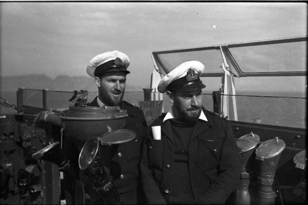 LT CDR R T Hale left, and LT Peter Silk right, in Korean waters on the bridge of HMNZS Taupo - members of the 'Whiskers Club' a group of crew members who had committed to growing beards whilst in Korea 1951/52