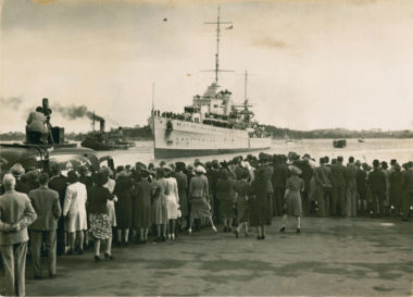 HMS Achilles sails in Auckland Harbour, February 1940